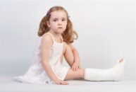 400-04675051 © artefy Model Release: Yes Property Release: No Little girl injured with broken ankle sitting on white backgound.